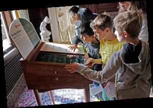 Kids playing serving utensil matching game