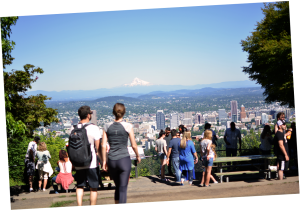 Visitors enjoying Pittock Mansion's view of Mount Hood and downtown Portland